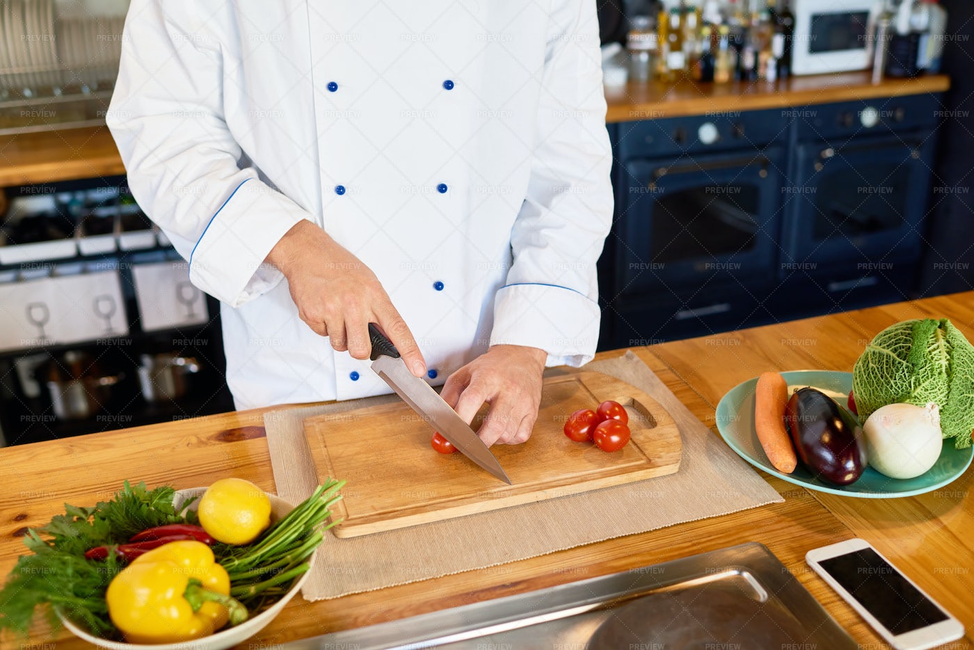 Professional  Chef Cutting Cherry...: Stock Photos