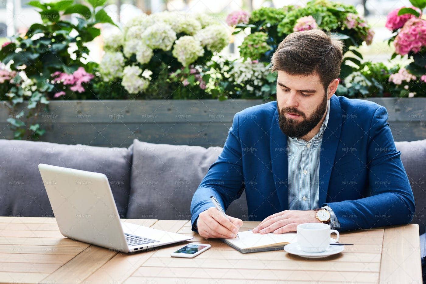 Modern Businessman Working In Cafe...: Stock Photos
