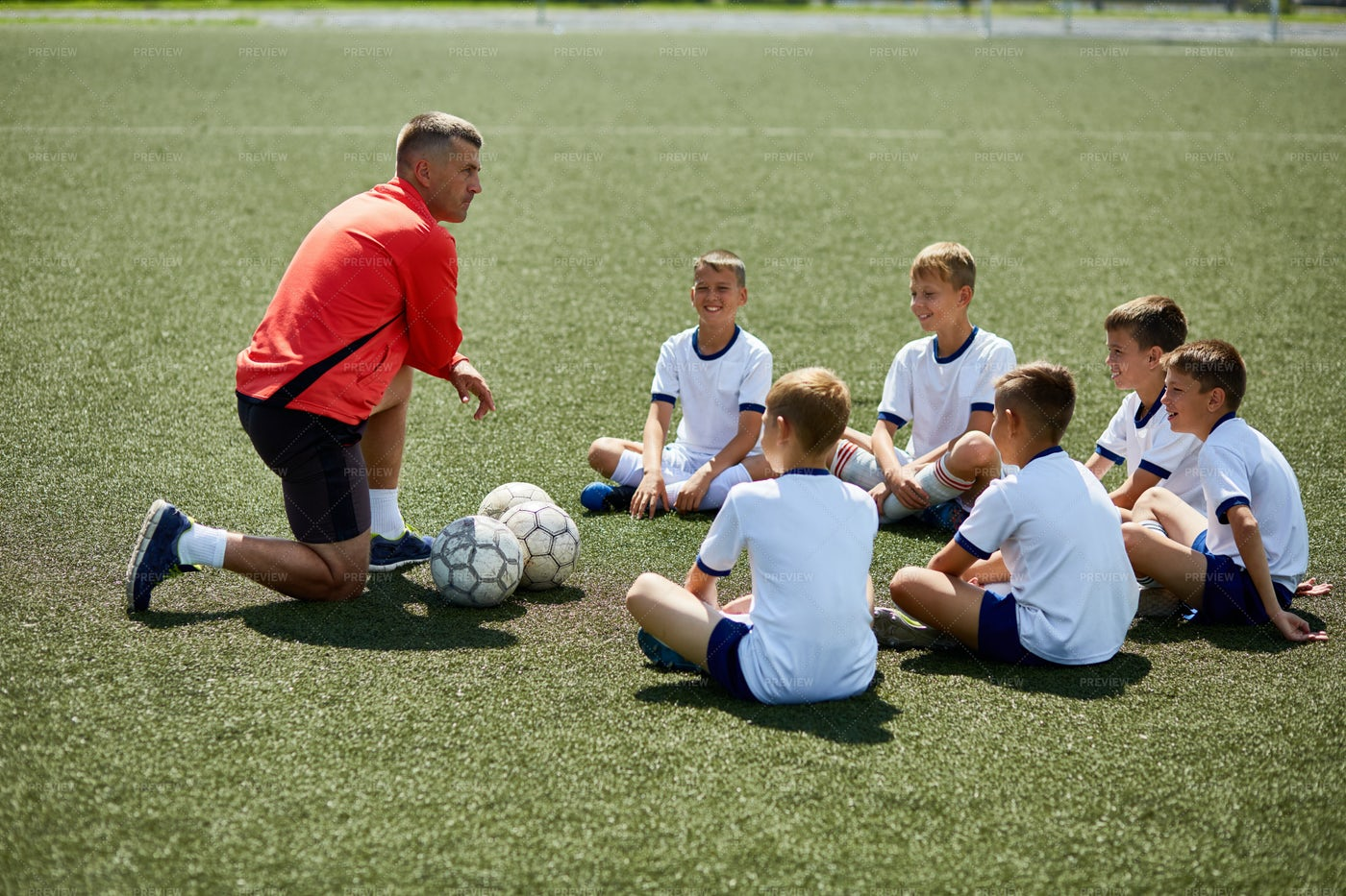 Coach Instructing Junior Football...: Stock Photos