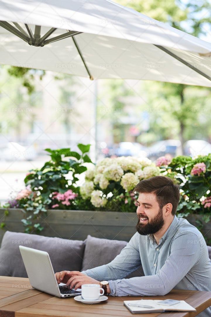 Smiling Bearded Businessman Working...: Stock Photos