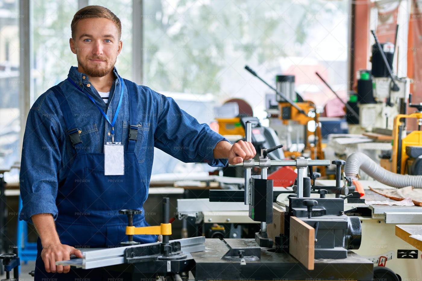 Workman Poising In Machine Units...: Stock Photos