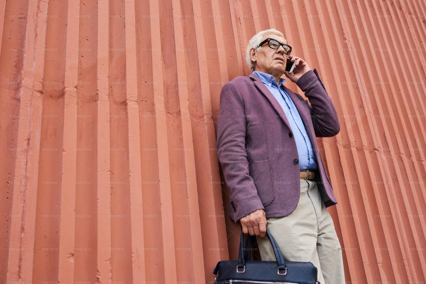 Stylish Senior Businessman Speaking...: Stock Photos
