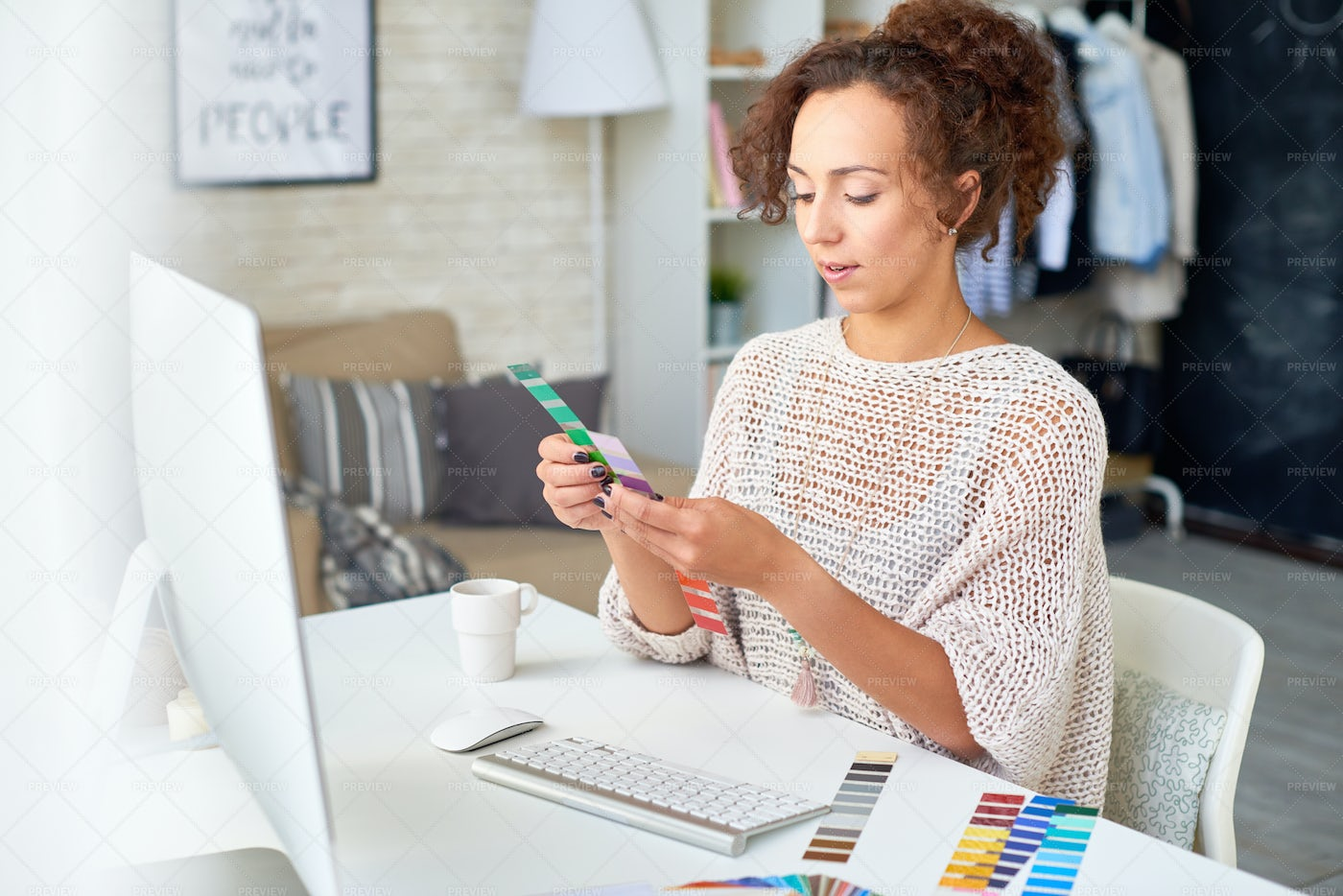 Young Woman Choosing Color Palette: Stock Photos