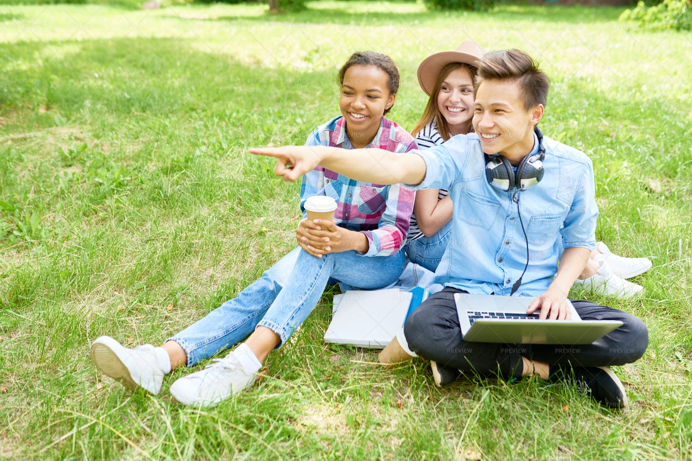 Happy Students  On Green  Lawn: Stock Photos