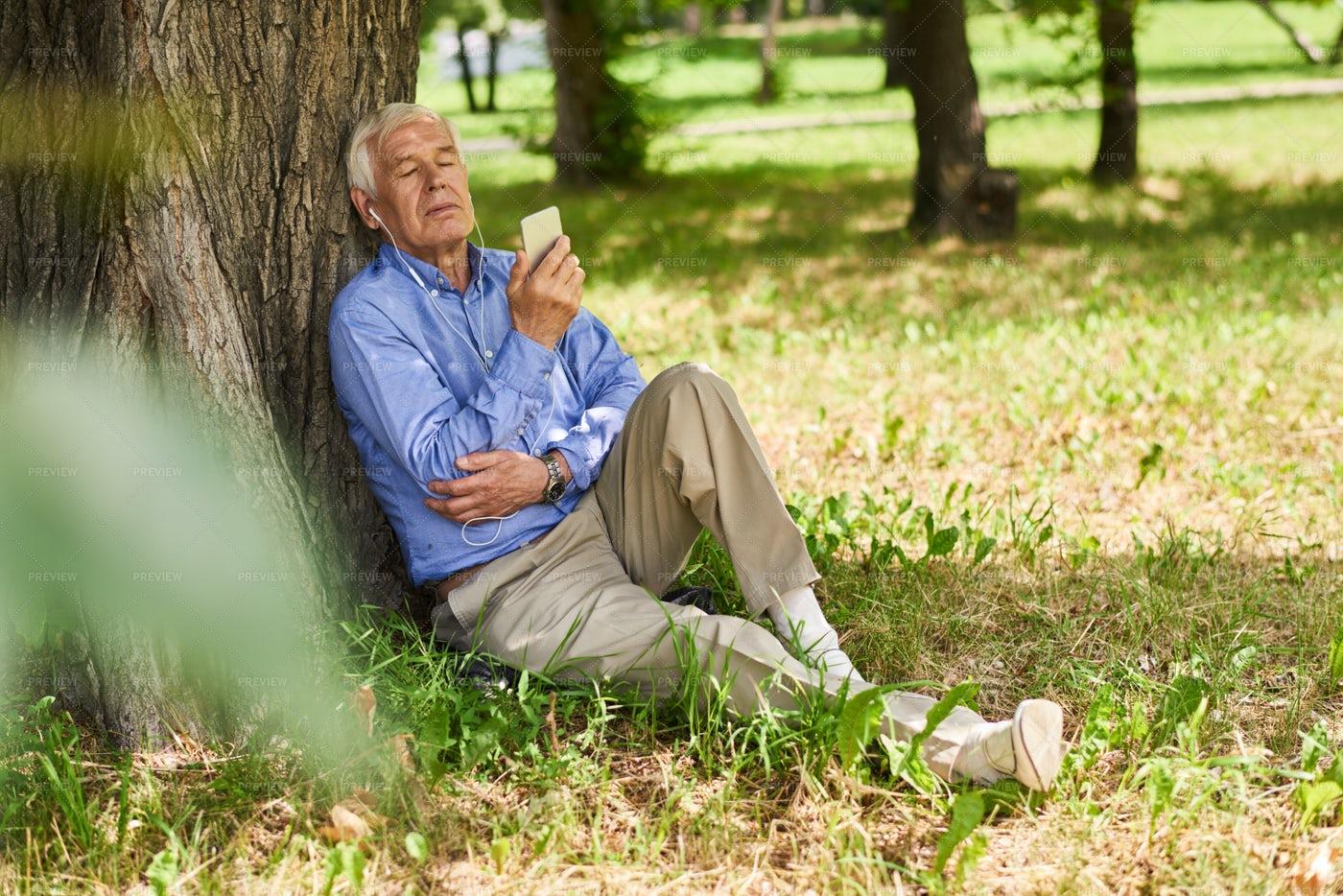 Senior Man Enjoying Weekend In Park: Stock Photos