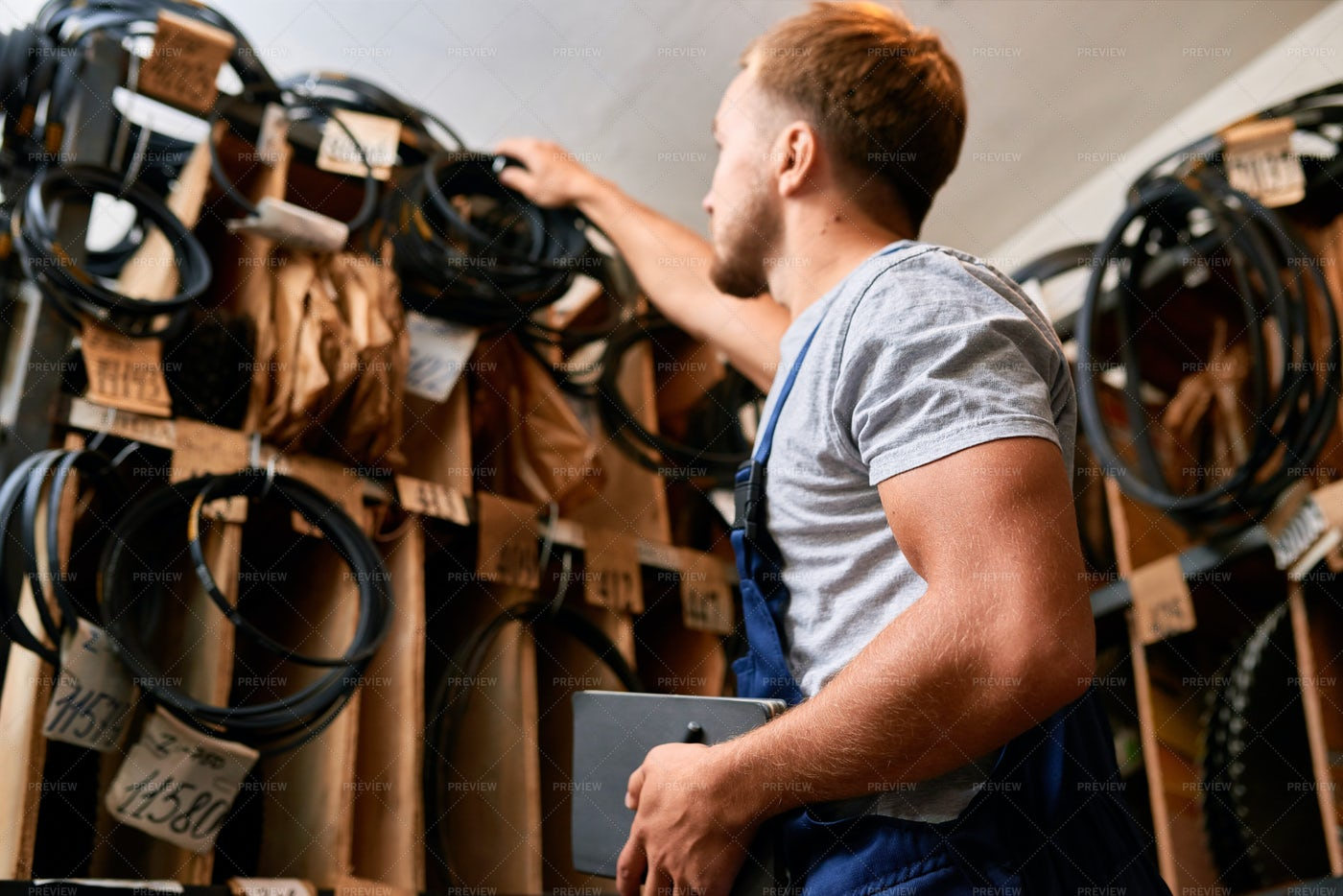 Mechanic Choosing Parts In Storage...: Stock Photos