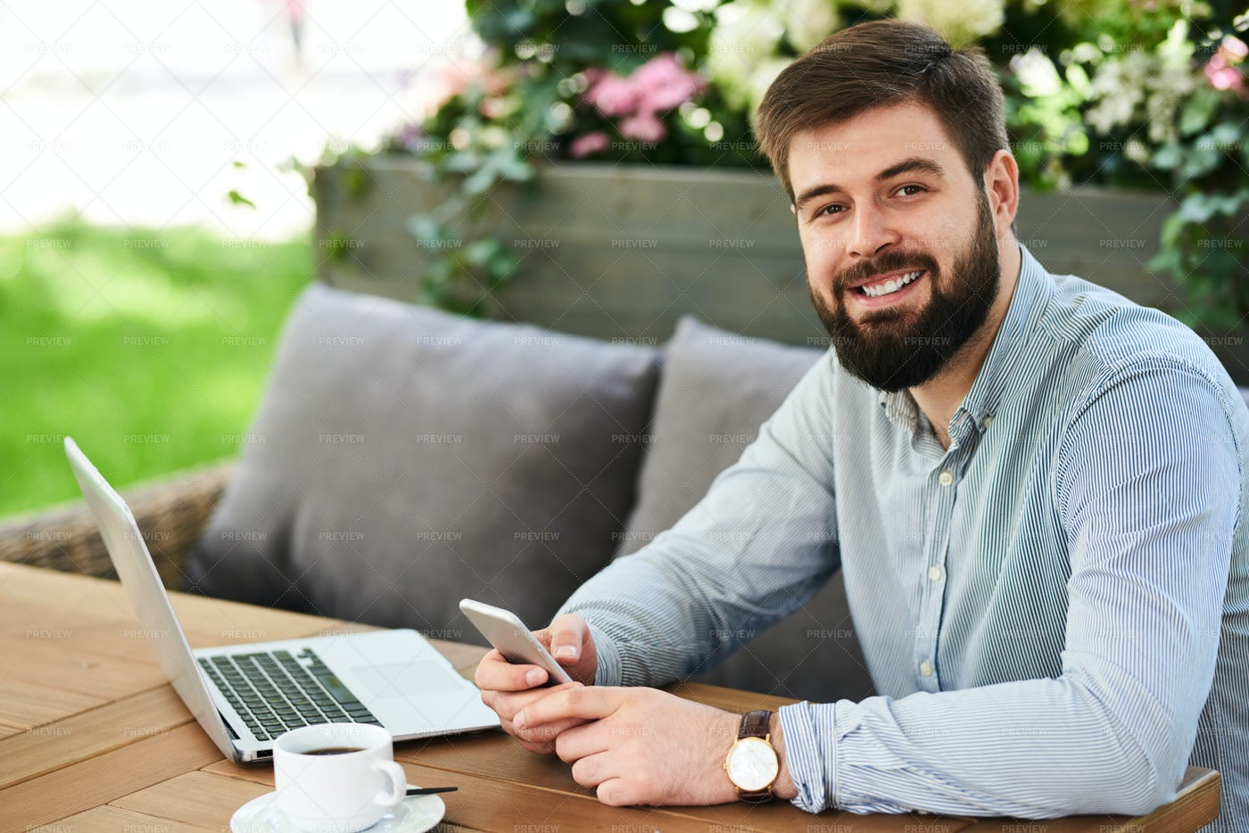 Smiling Businessman Working In Cafe: Stock Photos