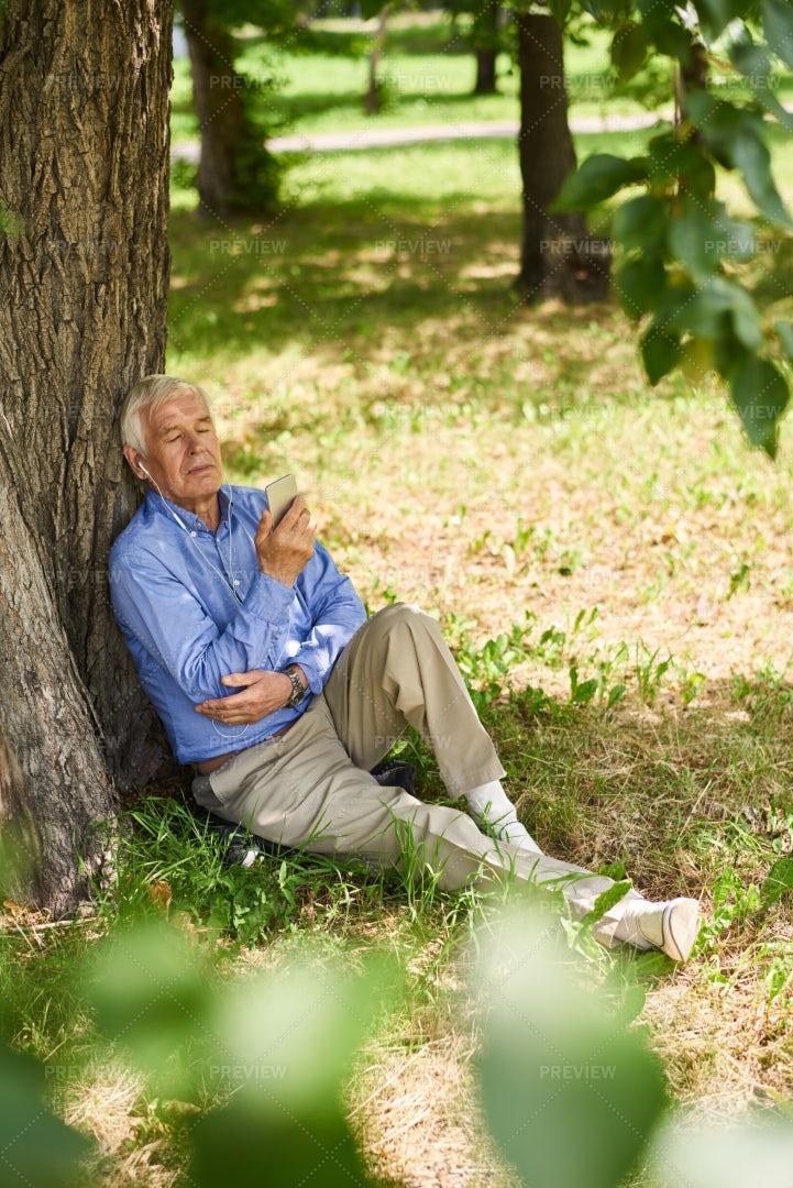 Senior Man Relaxing In Park: Stock Photos