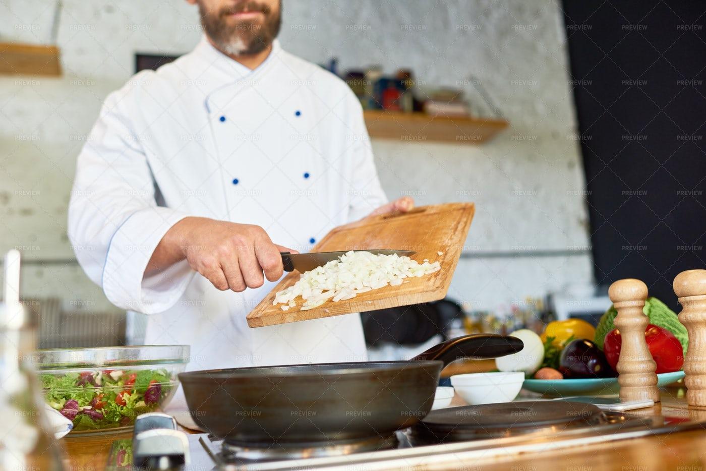 Caramelizing Onion In Restaurant...: Stock Photos