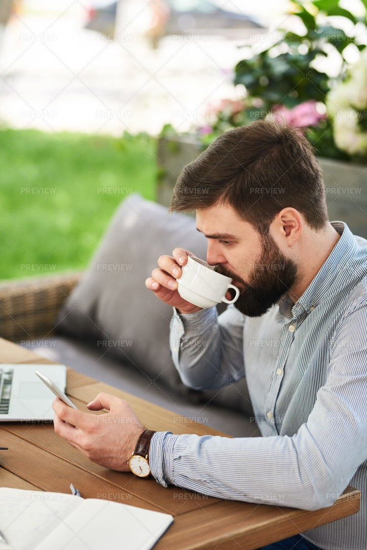 Bearded Businessman Working In Cafe: Stock Photos