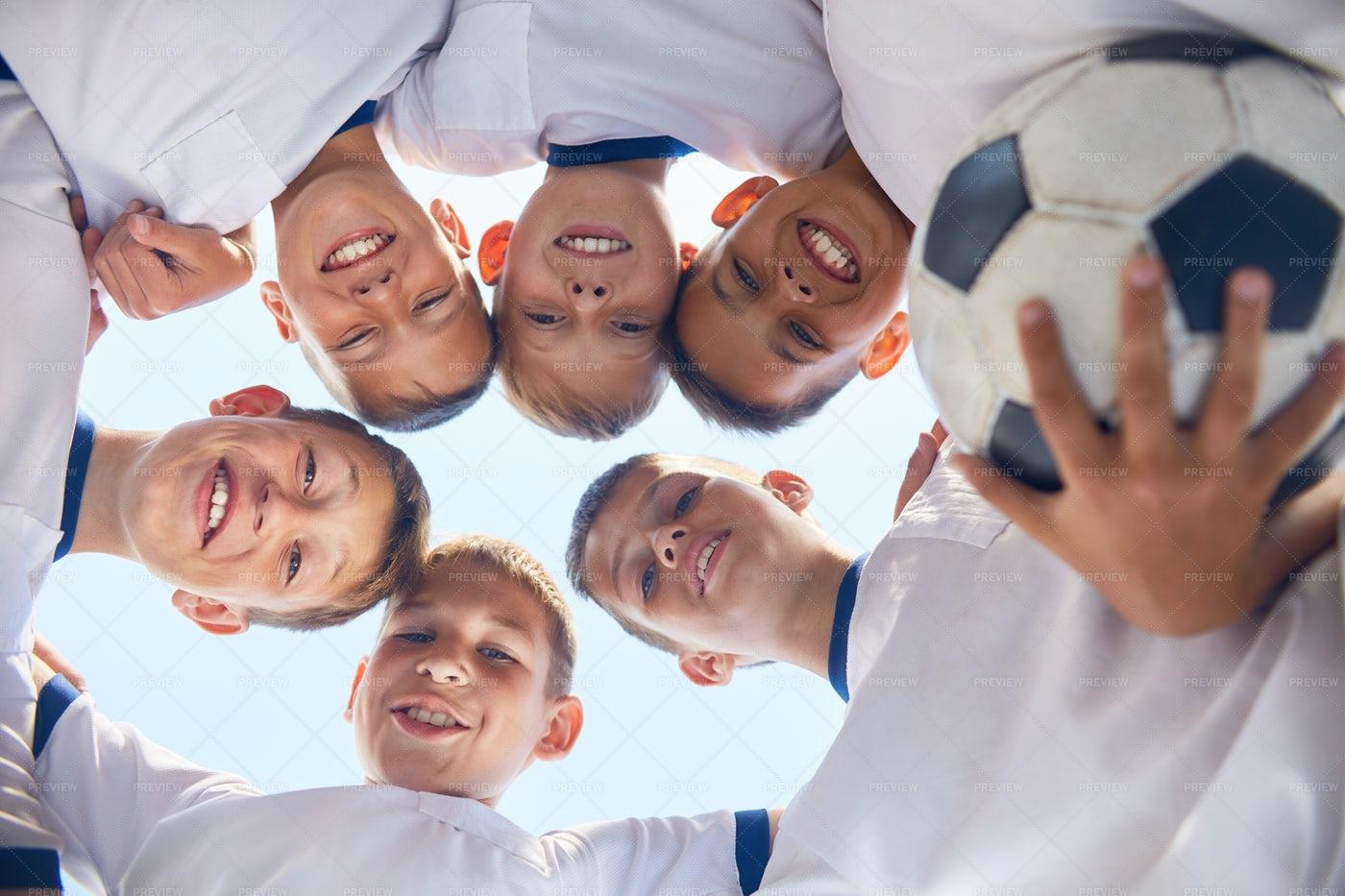Junior Football Team Huddling: Stock Photos
