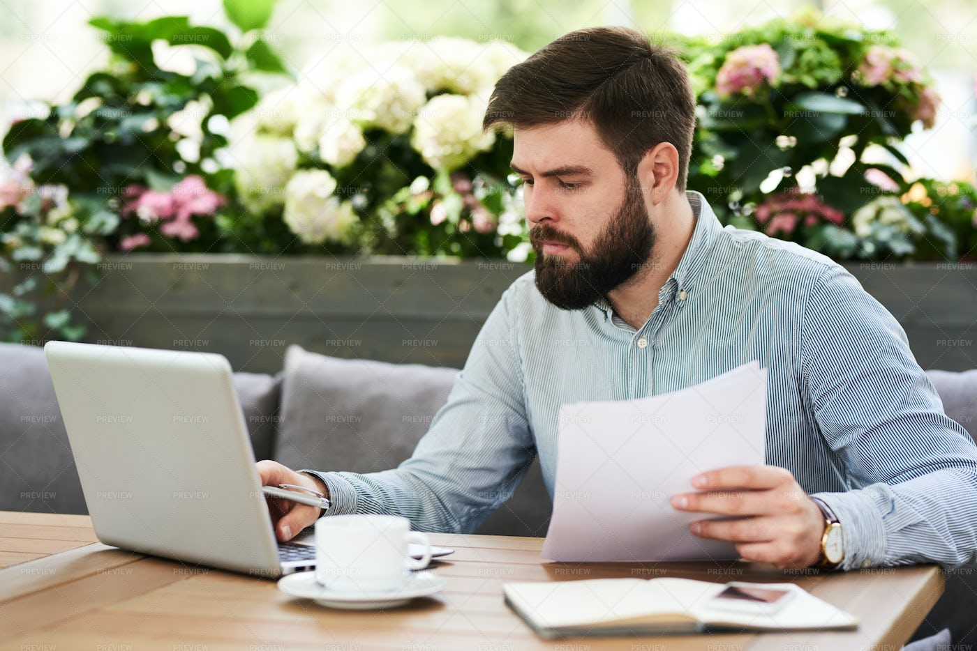 Busy Businessman Working In Cafe: Stock Photos