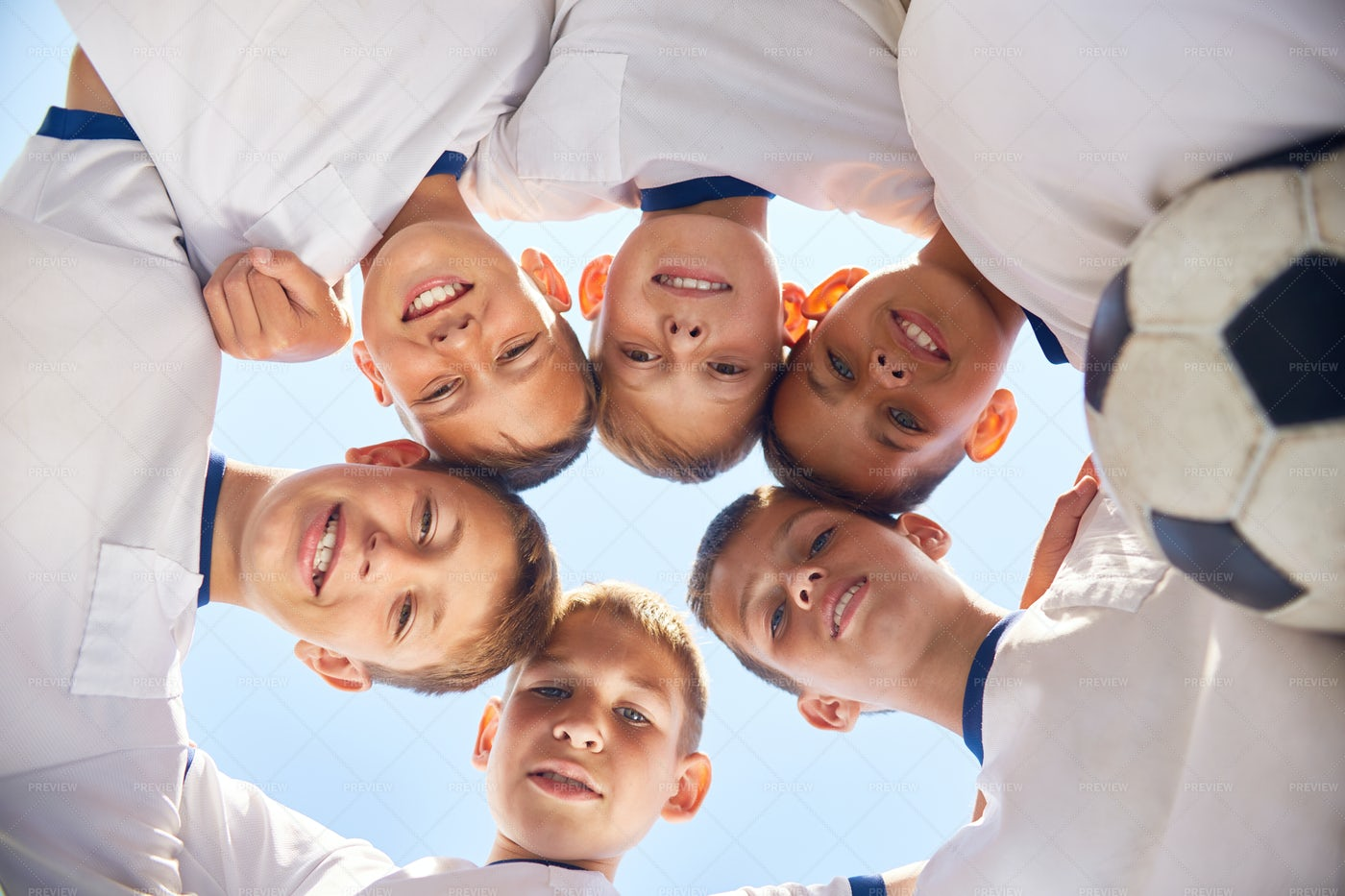 Junior Football Team Huddling...: Stock Photos