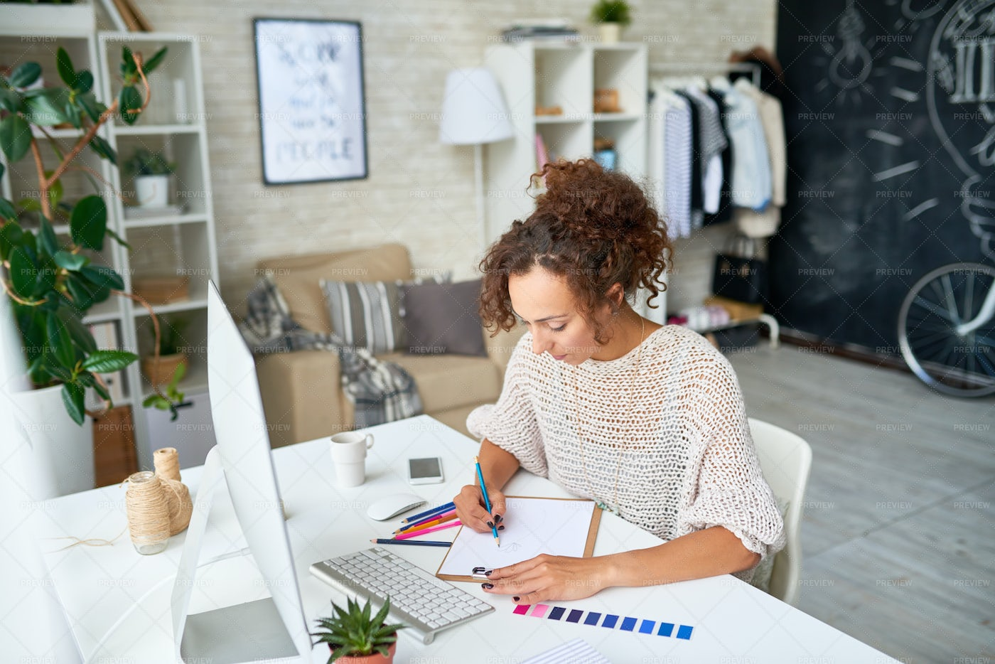 Creative Young Woman Working From...: Stock Photos