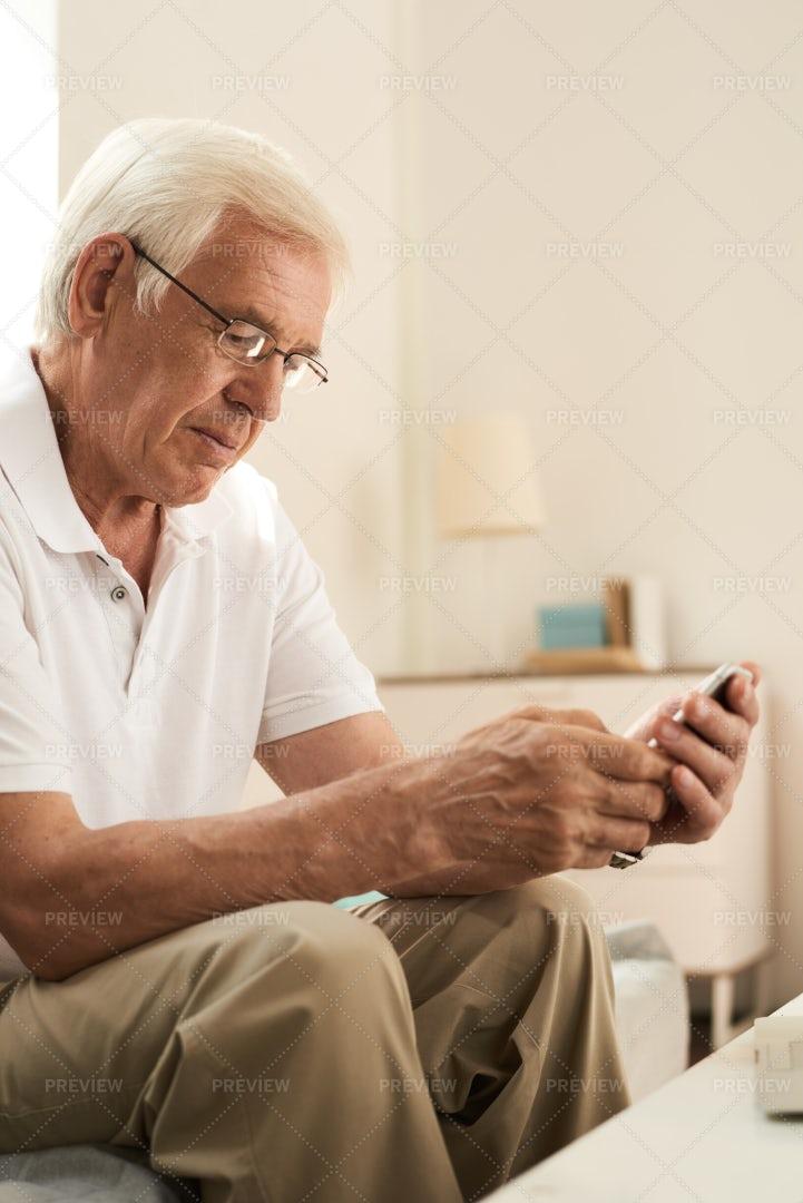Senior Man Learning To Use...: Stock Photos