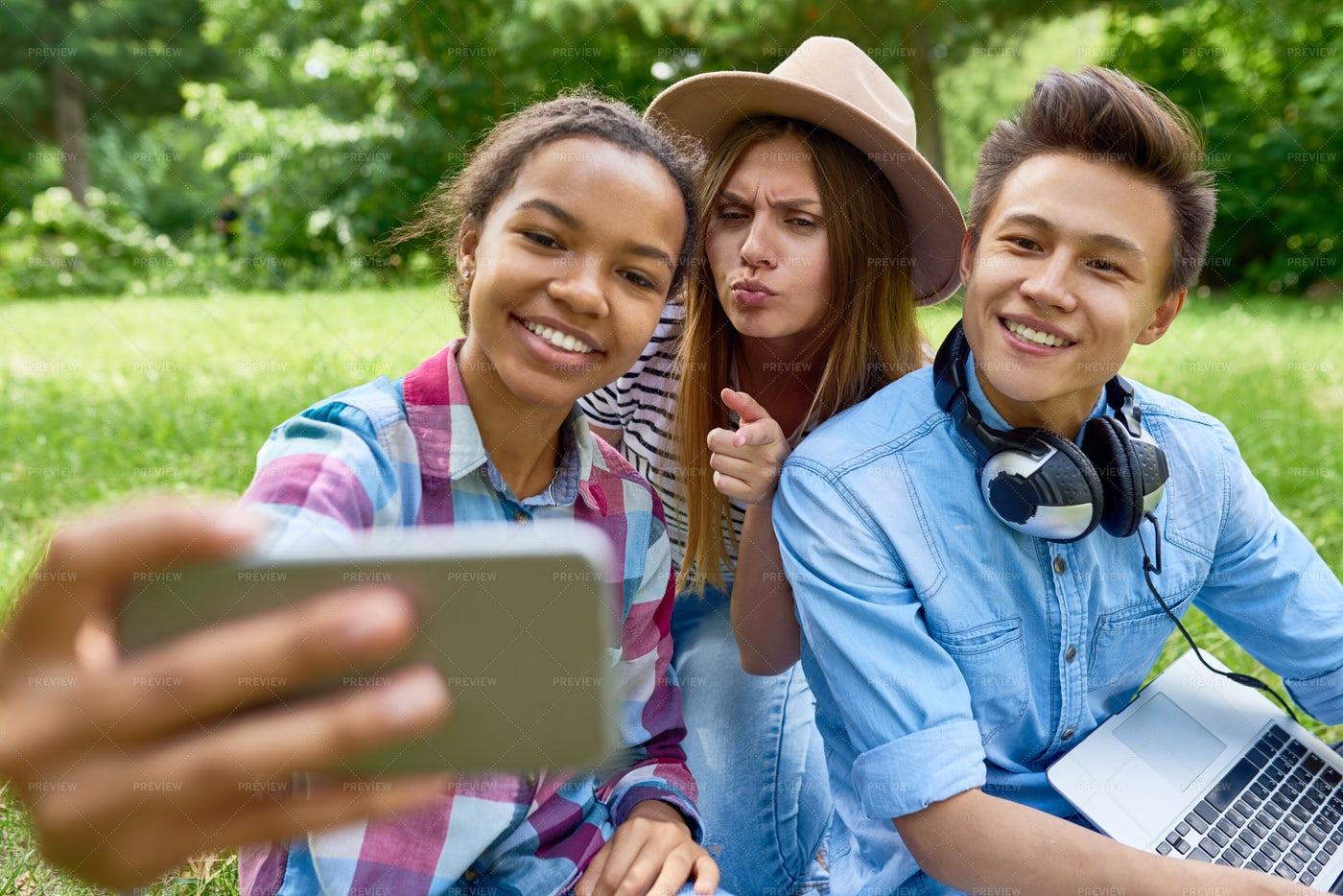 Friends Taking Selfie In Park: Stock Photos