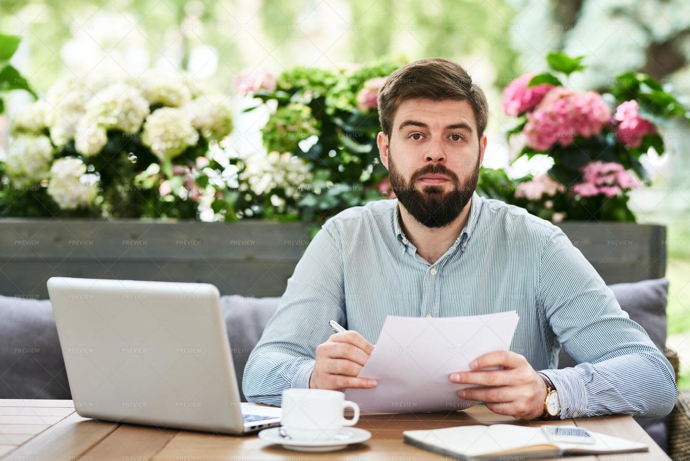 Bearded Entrepreneur Working In...: Stock Photos
