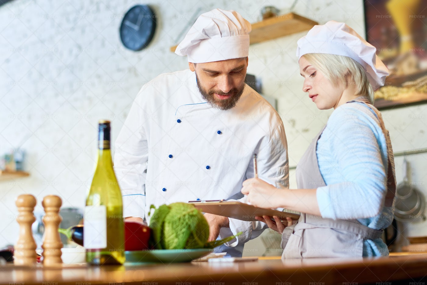 Chef Working In Cafe Kitchen: Stock Photos