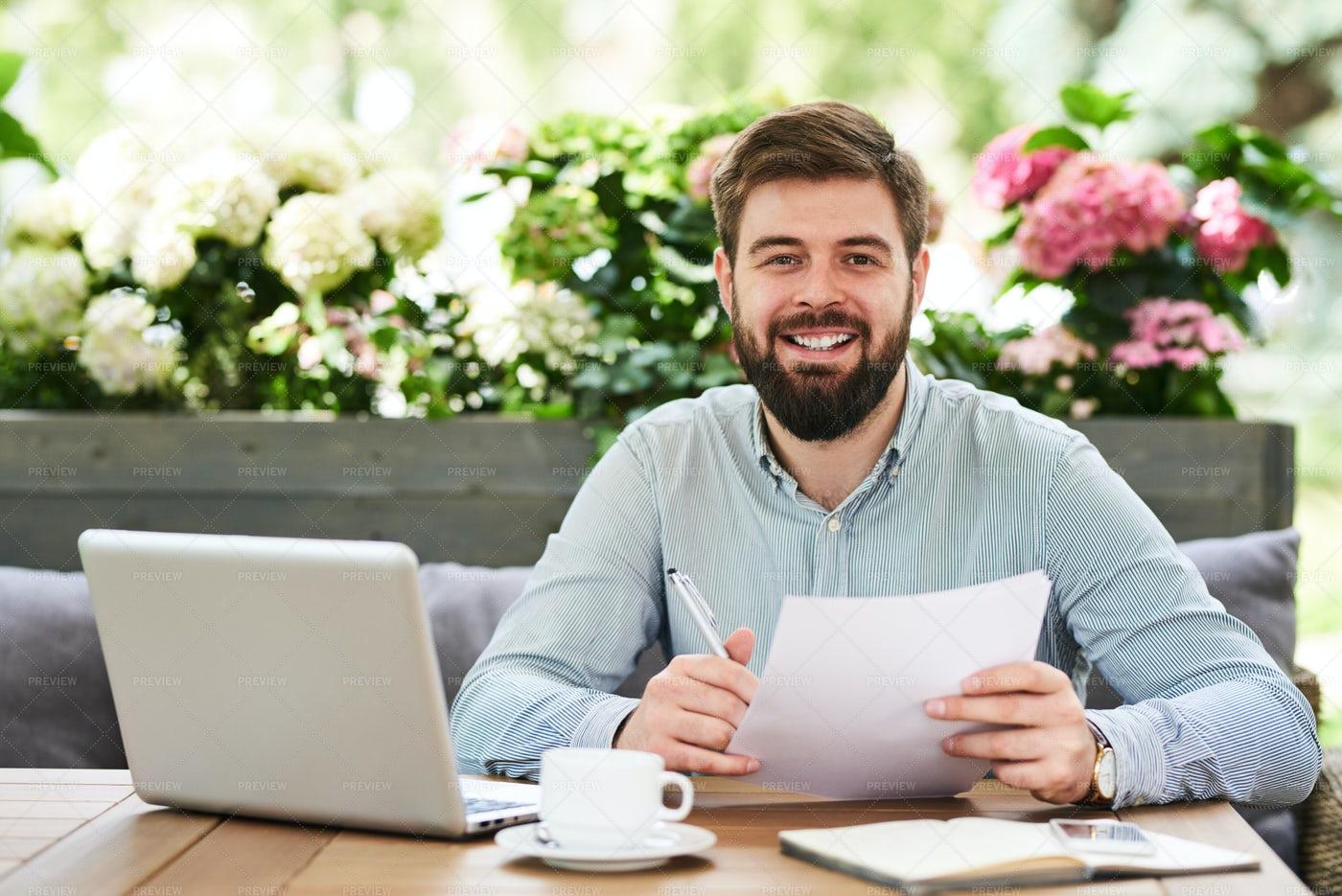 Smiling Entrepreneur Working In...: Stock Photos