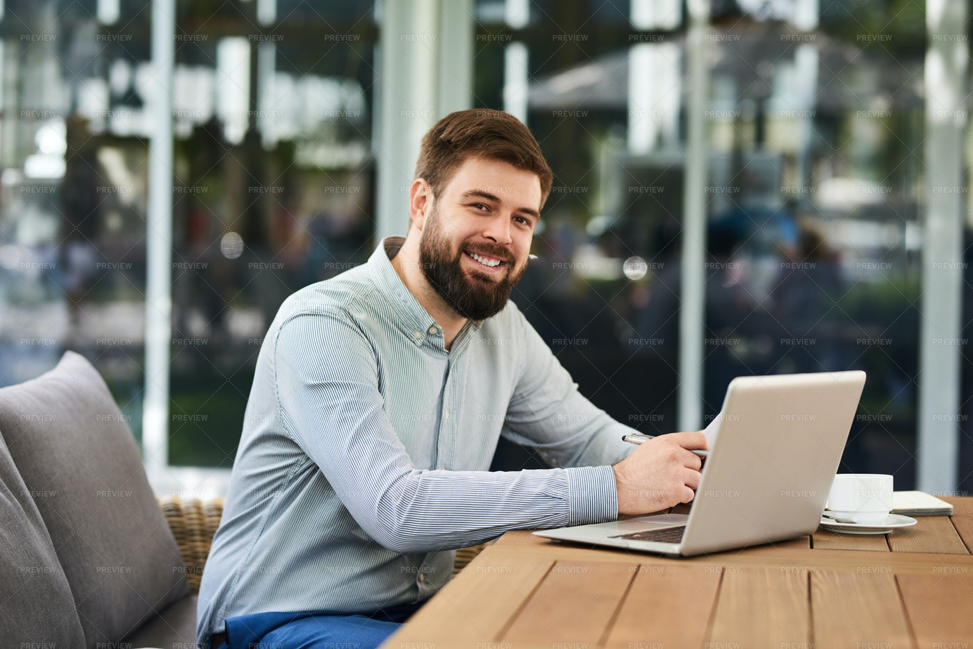 Smiling Bearded Man Working In...: Stock Photos