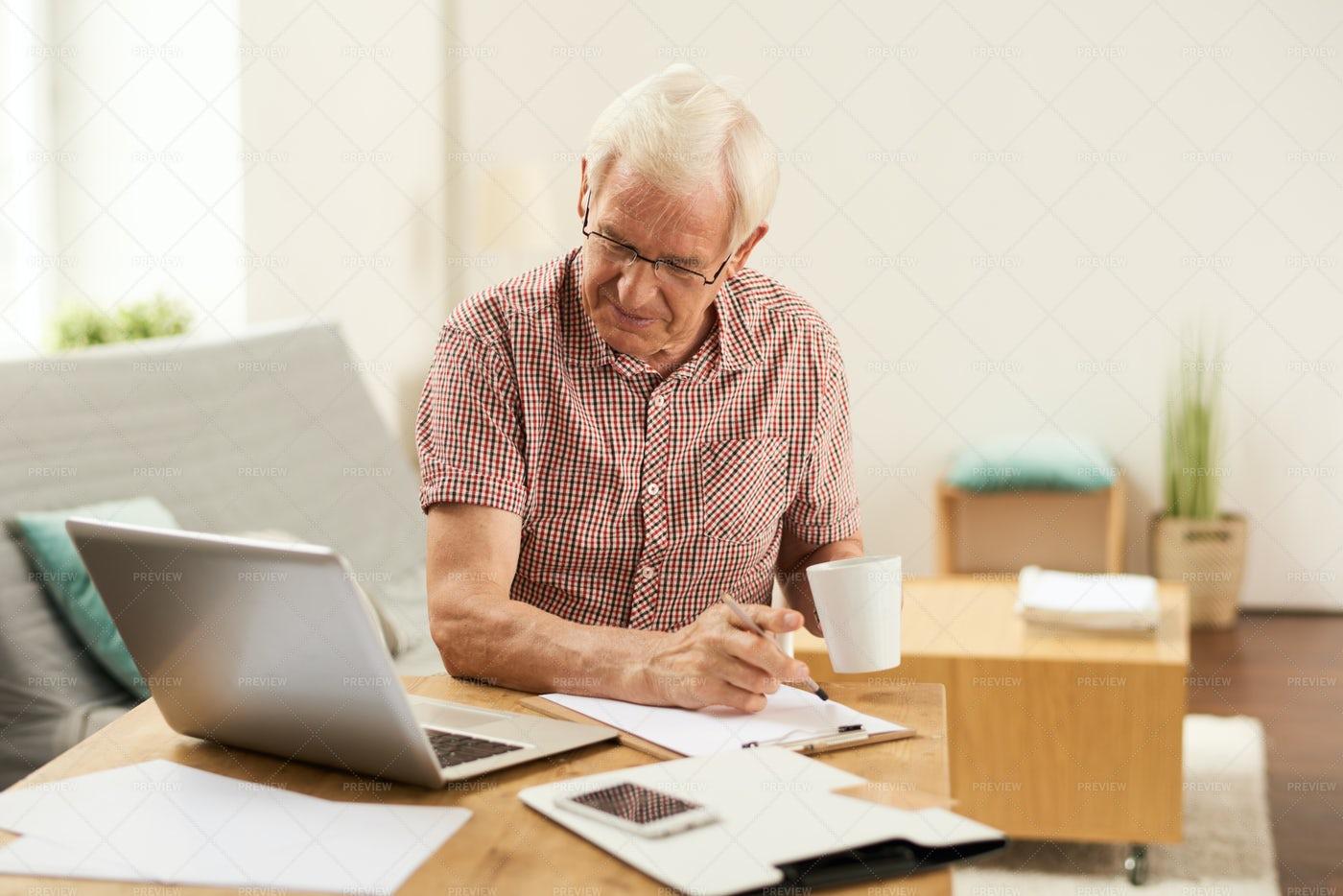 Senior Man Counting Taxes At Home: Stock Photos