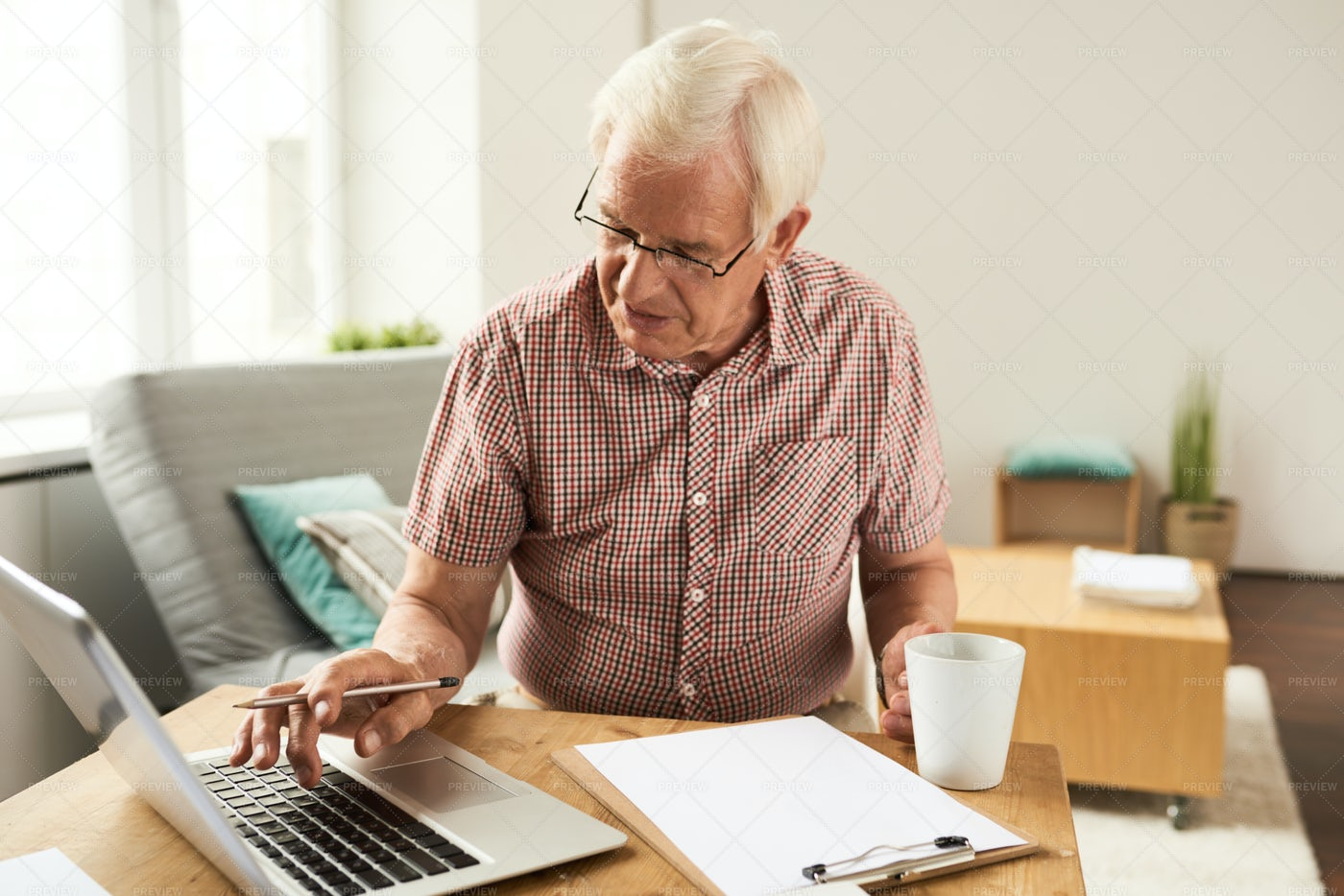 Senior Man Working With Laptop At...: Stock Photos