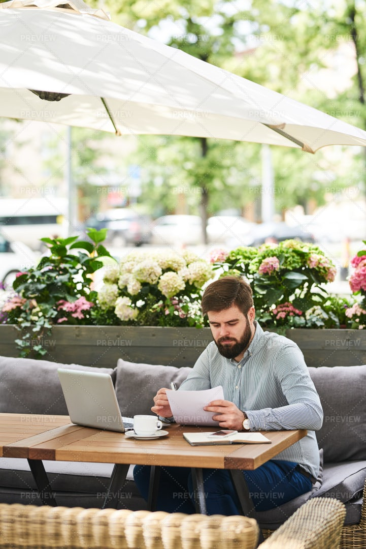 Busy Businessman Working In Cafe...: Stock Photos