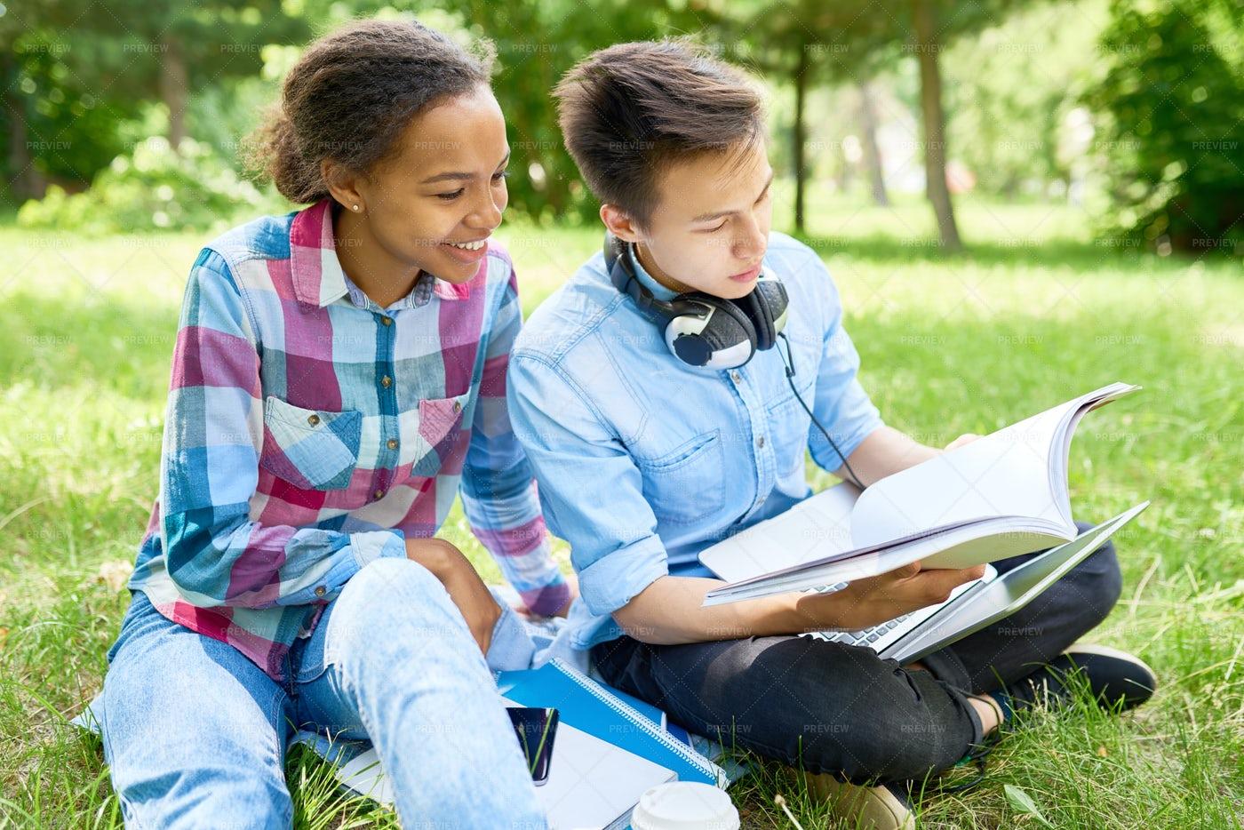 Couple Of Students Doing Homework...: Stock Photos