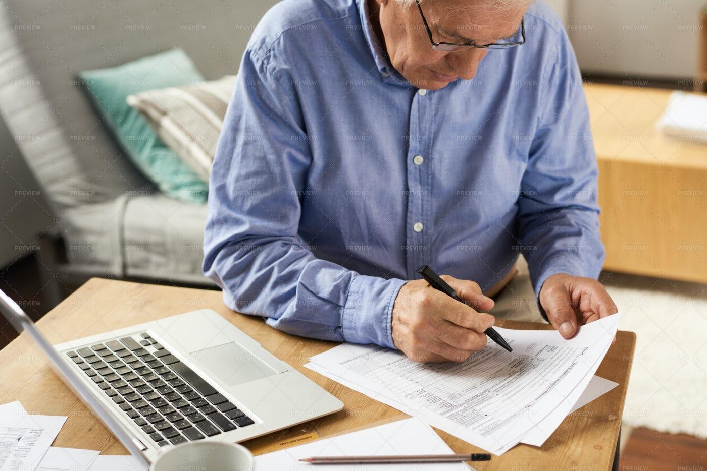 Senior Man Filling Application Form...: Stock Photos