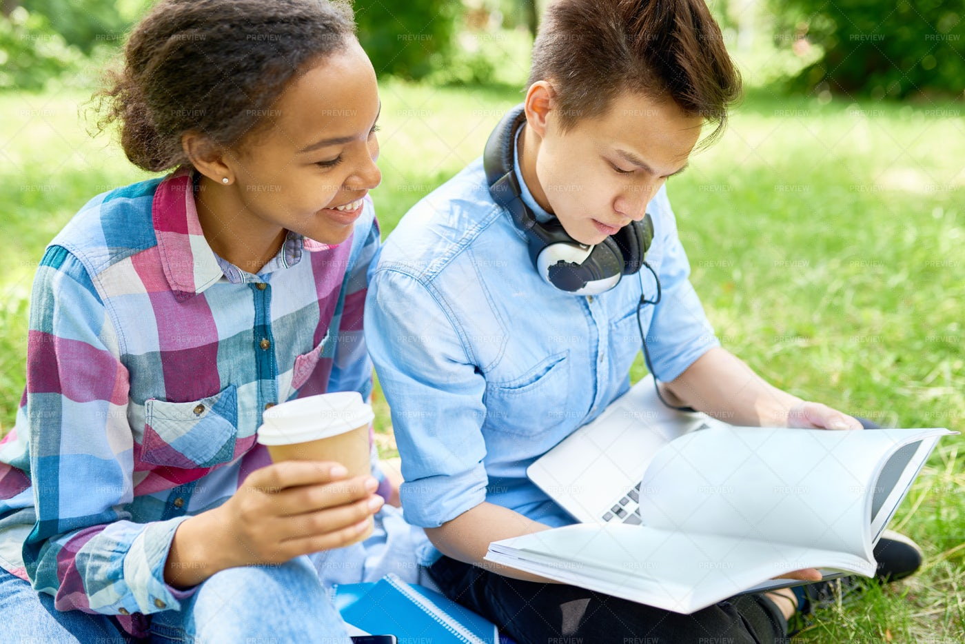 Students Doing Homework Outdoors: Stock Photos