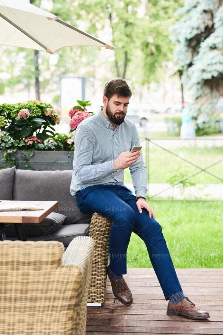 Contemporary Man Using Smartphone...: Stock Photos