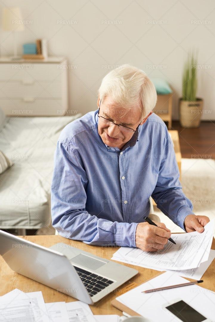 Senior Man Filling Application At...: Stock Photos