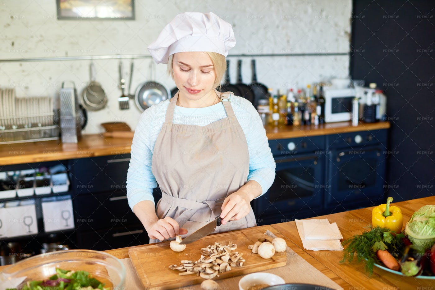 Young Female Cook Working In...: Stock Photos