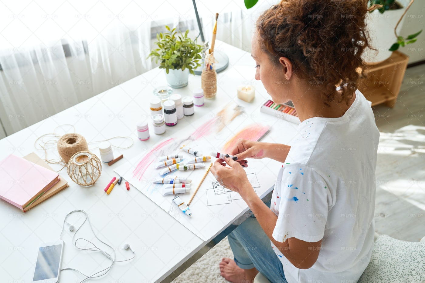 Creative Young Woman Painting With...: Stock Photos