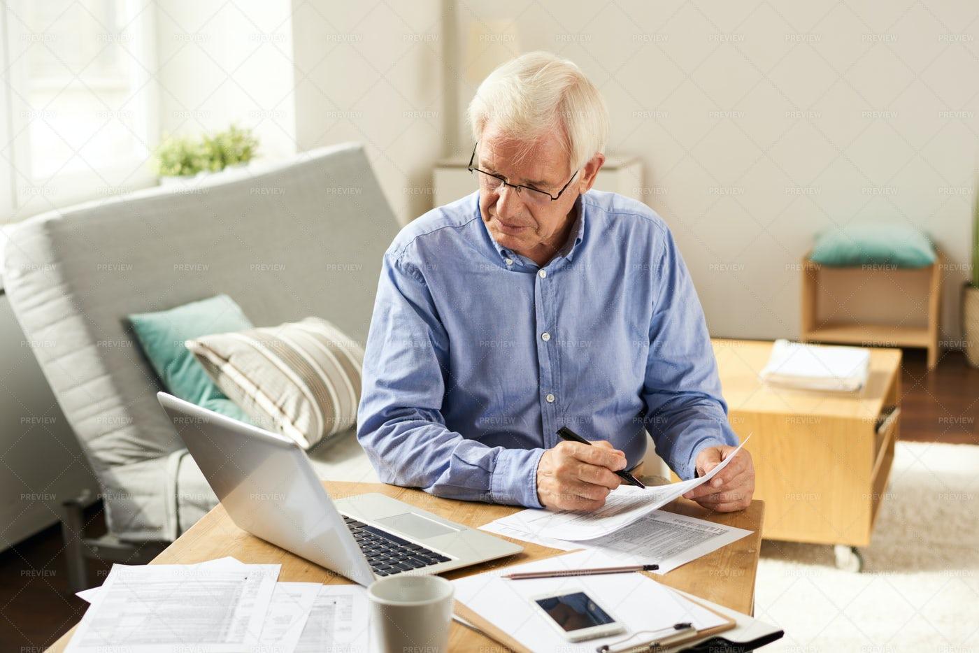 Senior Man Filing Tax Report At...: Stock Photos
