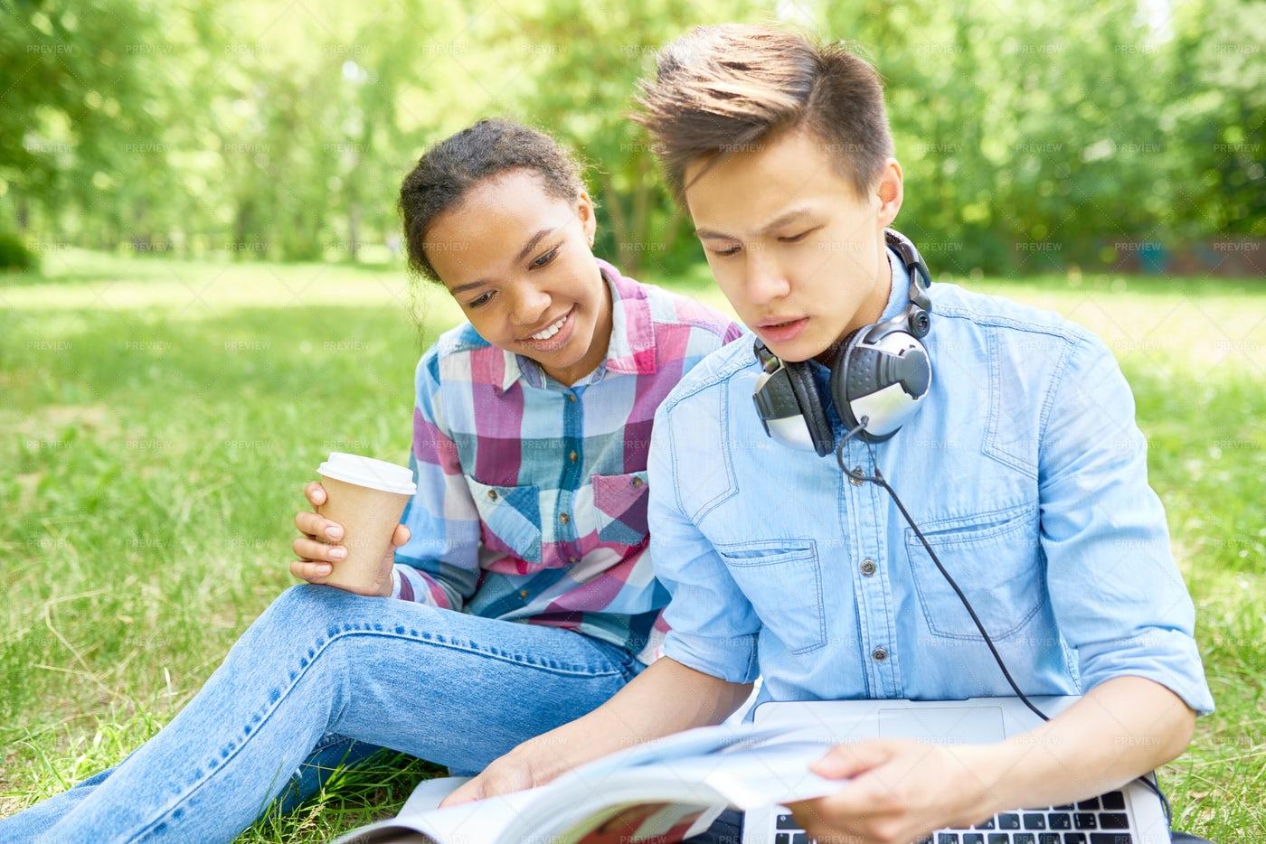 Students Doing Homework Outdoors On...: Stock Photos