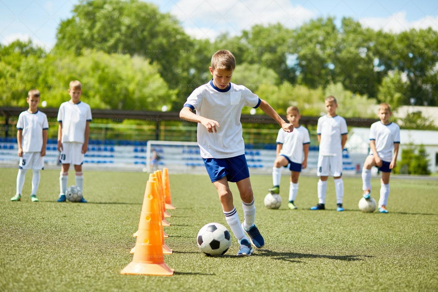 Junior Football Player At Practice: Stock Photos