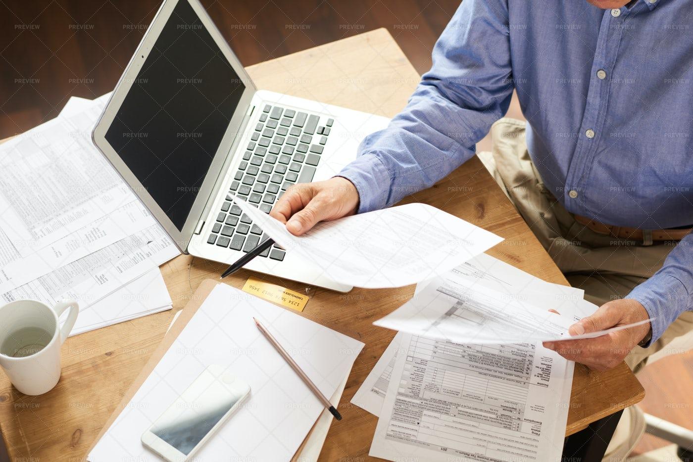 Senior Man Writing Applications: Stock Photos