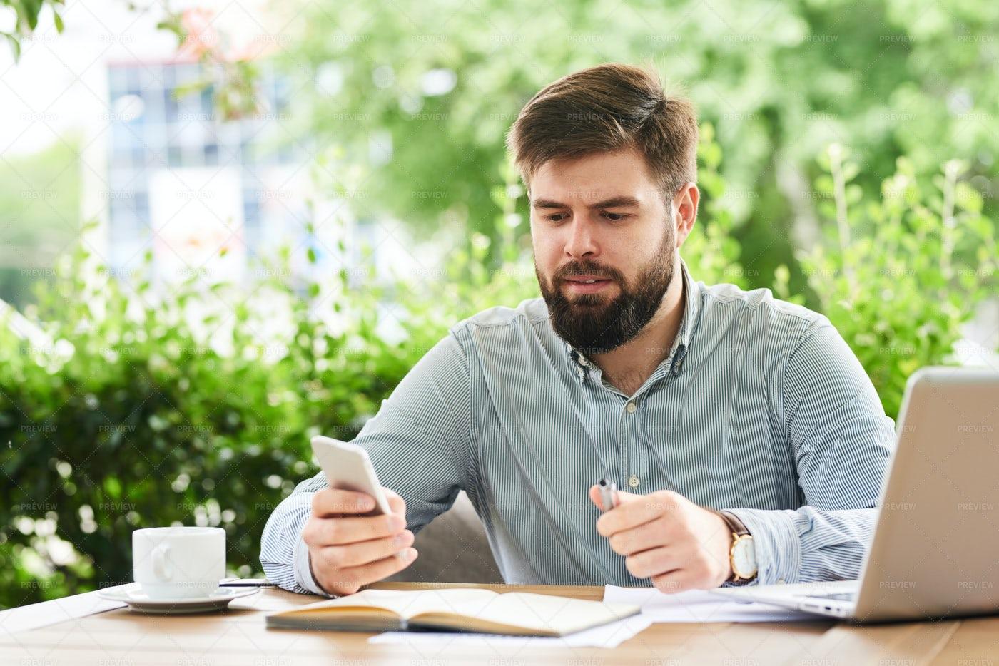 Businessman Using Smartphone For...: Stock Photos