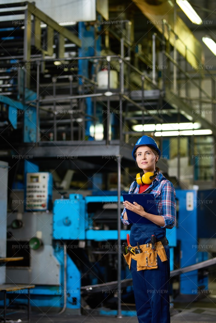 Young Woman Working In Factory: Stock Photos