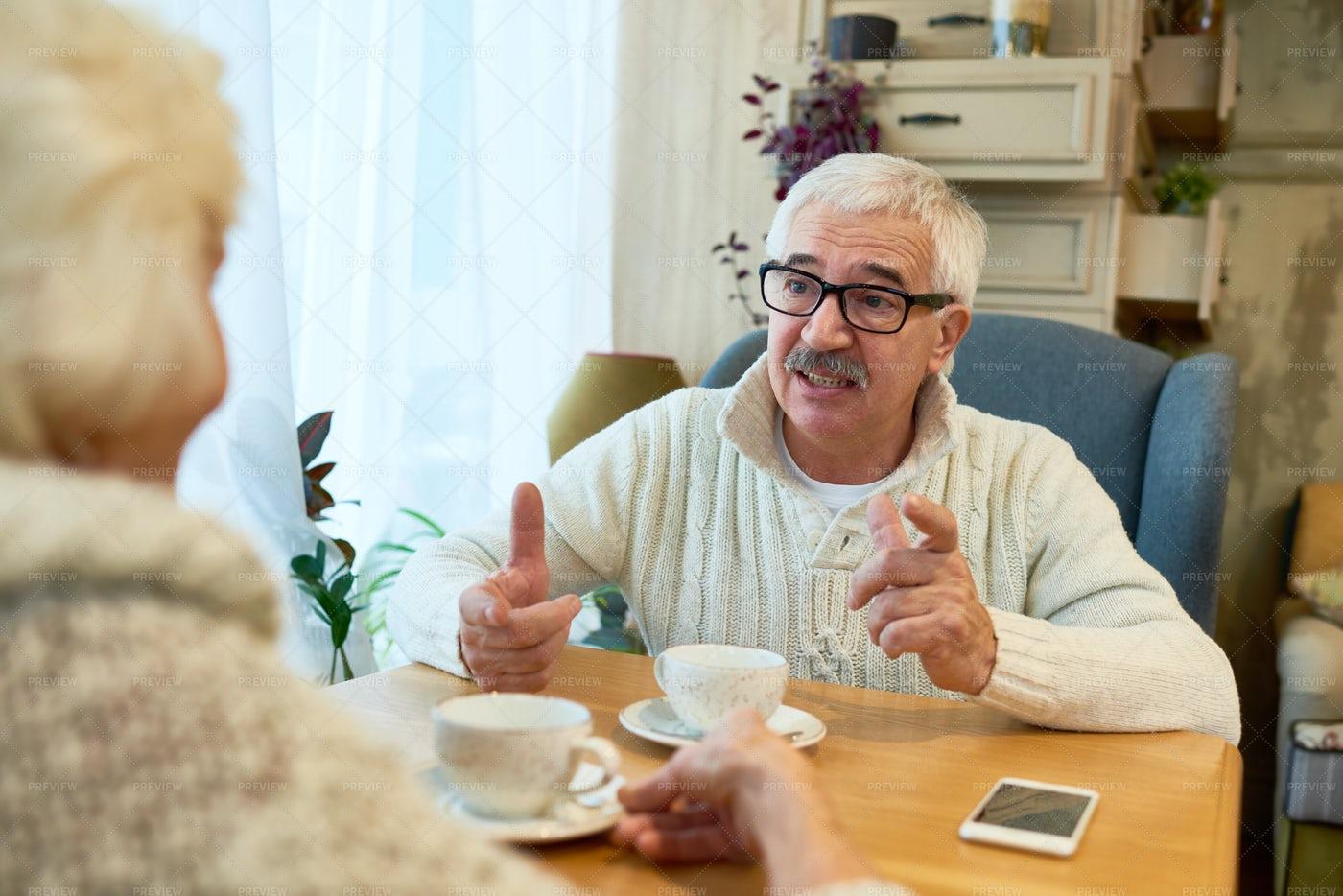 Senior Couple Enjoying Tea Time: Stock Photos