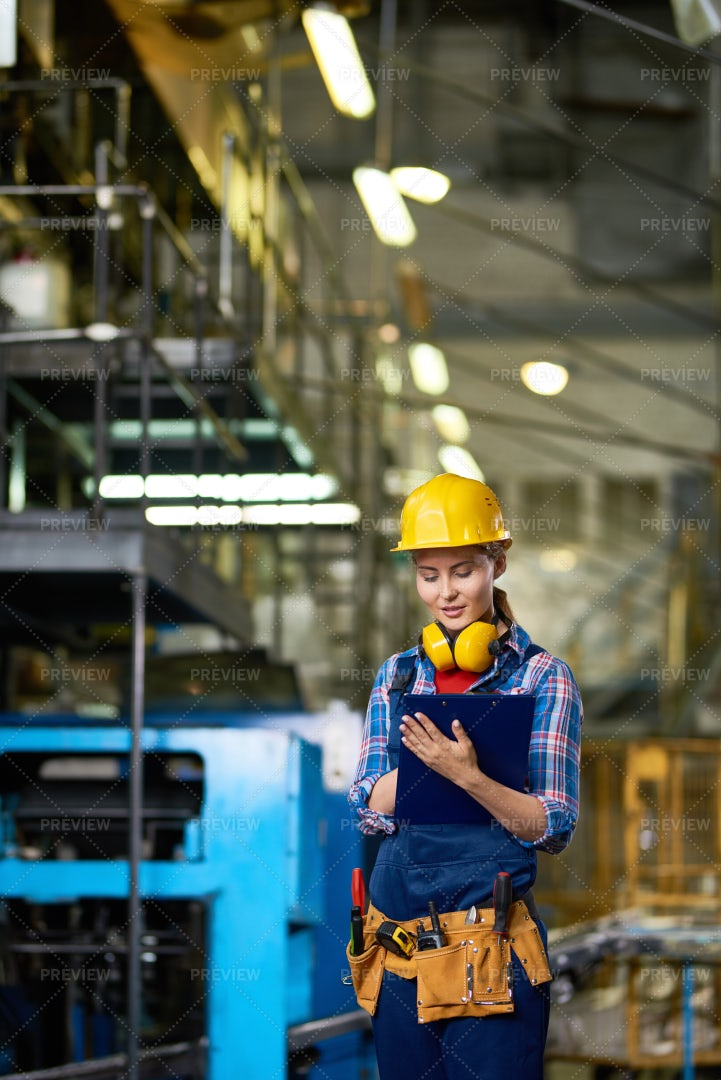 Female Worker At Factory: Stock Photos