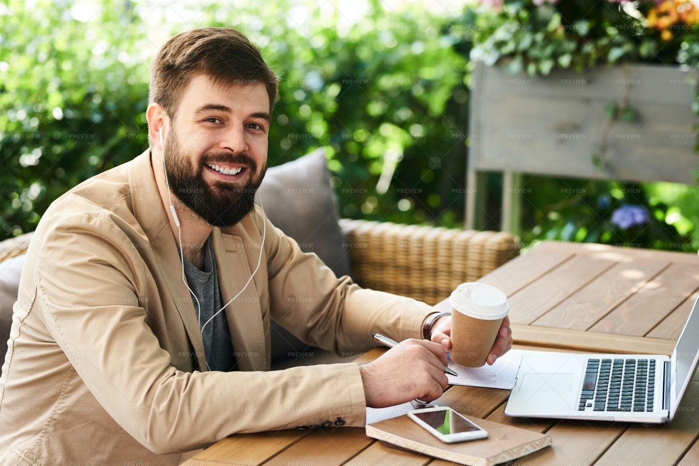 Smiling Modern Businessman Working...: Stock Photos