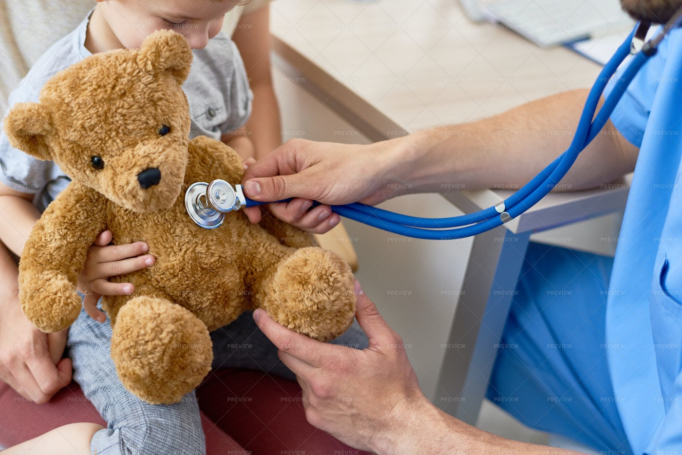 Young Pediatrician Playing With...: Stock Photos