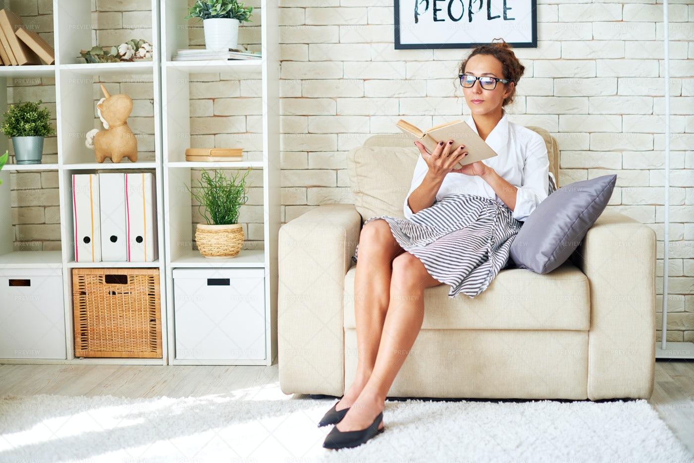 Elegant Young Woman Reading Book At...: Stock Photos