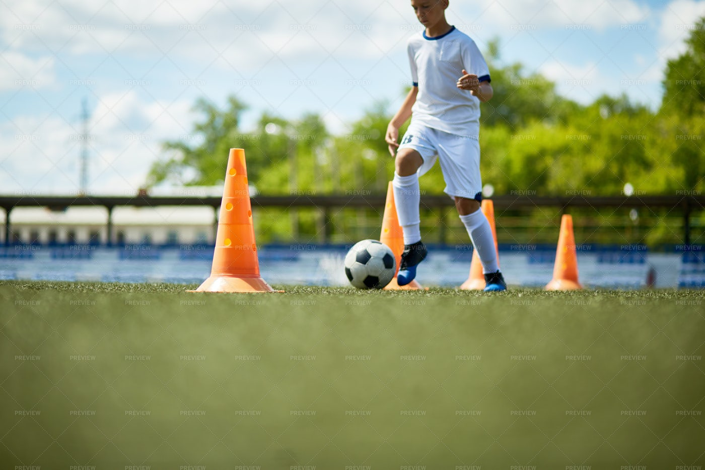Boy Training In Football Field: Stock Photos