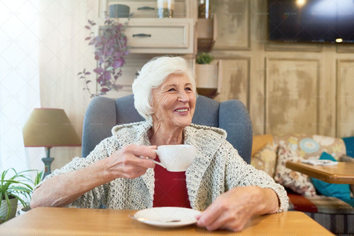 Happy Senior Lady Enjoying Tea: Stock Photos