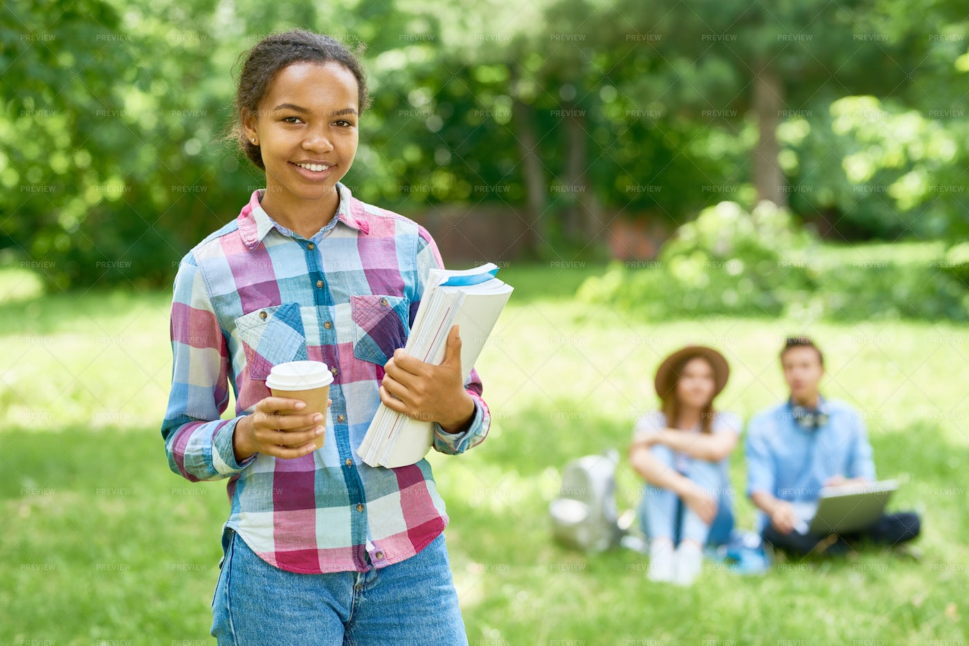 Cheery African American Student Outdoors: Stock Photos