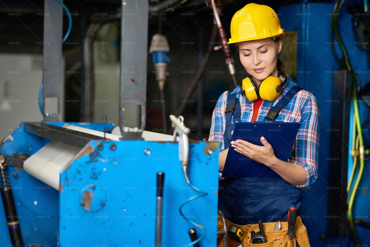 Smiling Female Worker At Modern...: Stock Photos