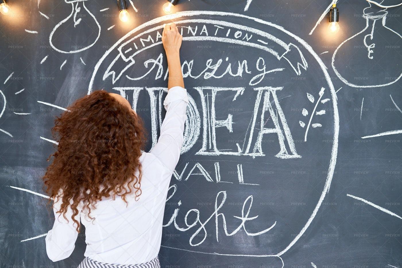 Young Woman Drawing Inspirational...: Stock Photos
